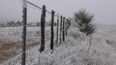 Texas icy fence with car in background Stock Footage