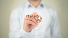 Expertise, man writing on transparent screen Stock Footage