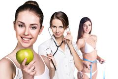 Woman with apple and perfect body - stock photo