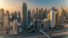 Beautiful aerial top view at sunset timelapse of Dubai Marina and JLT in Dubai Stock Footage