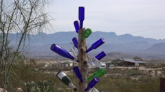 Texas Terlingua bottles stuck on a pole Stock Footage