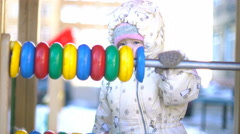 Baby girl playing with colorful abacus 4k UHD (3840x2160) Stock Footage