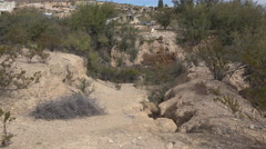 Texas Terlingua gully zooms toward flowers Stock Footage