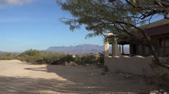 Texas Terlingua mountain beyond building zooms in Stock Footage