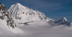 Epic Scenic Alaskan Mountains with Low Flying Airplane Passing Stock Footage