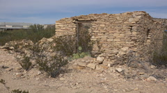 Texas Terlingua stone ruin with distant Trading Center zoom out Stock Footage