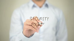 Security Policy, man writing on transparent screen - stock footage