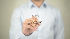 Key Issues, man writing on transparent screen Stock Footage