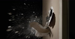 Smashing through Drywall in slow motion - Sledge Hammer Stock Footage