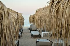 Sunbeds and Parasols on the Beach Stock Photos