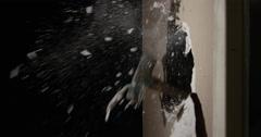 Hammer Smashing through Drywall in slow motion Stock Footage