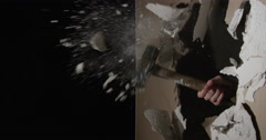 Hammer and dust Smashing through Drywall in slow motion - stock footage