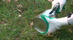 Make a brazier from a can, break the can body into strips Stock Footage
