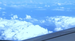 View from airplane: piece of the craft, skies and clouds Stock Footage