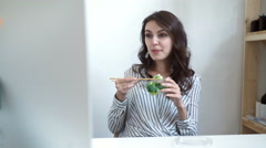 business woman enjoying fresh salad for lunch break at office desk - stock footage