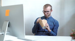 Businessman eating chinese food while having an internet call Stock Footage
