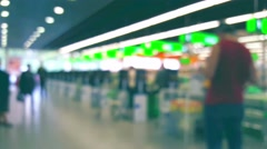 Checkout counter in a supermarket, blurred background Stock Footage