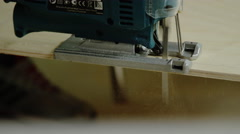 Electric fretsaw cutting a plywood Stock Footage