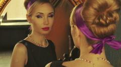 Beautiful Blond Model looks in mirror Stock Footage