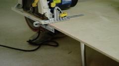 Circular saw cutting a plywood Stock Footage