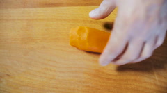 Chef Hands Cutting Carrot On Wooden Board Stock Footage
