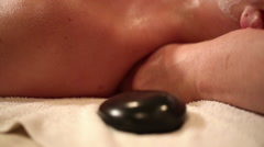 Hot Stones Neck and Shoulder Massage Tilt Down Stock Footage