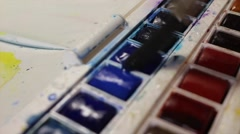 Loading Paintbrush with Watercolor Paint (Half pan) Stock Footage