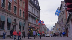 Old Port Montreal People Walking Street Flags Stock Footage