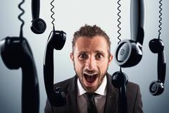 Stressful phone calls Stock Photos