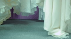 Bride Chooses Dress In Bridal shop Stock Footage