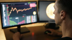Man works on the financial market on computer Stock Footage