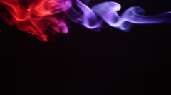 Colorful Smoke On Black Background, Slow Motion. Real scene. Pink, Red Stock Footage
