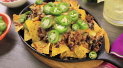 Classic nachos with ground beef and fresh jalapeno chili peppers. Stock Footage