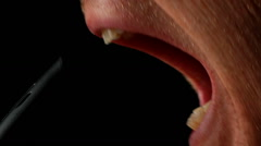 Man's Mouth Talking Into Mic - stock footage