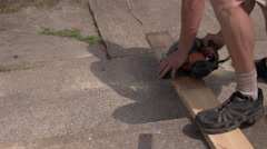 Worker Cutting Wood with Power Saw. Stock Footage