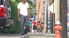 African American kids Walking on Sidewalk Stock Footage
