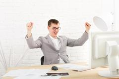 Young businessman in office with computer Stock Photos