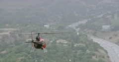 WS AERIAL TS Helicopter flying over city with busy street - stock footage