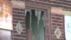Broken window on Boarded up Business Cleveland, Ohio Stock Footage