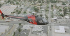 MS AERIAL TS Helicopter flying over city with parking area - stock footage