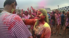 People covered in coloured powder enjoying foam party during 'Holi Festival ' Stock Footage