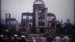 3266 Hiroshima Peace Memorial visited by US sailors  - vintage film home movie Stock Footage