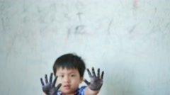 Little boy has color dirty hands and smile happyness Stock Footage
