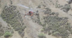 WS AERIAL TS ZI View of helicopter moving above mountain - stock footage