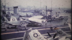 3254 camera pans the deck of US Naval Aircraft Carrier - vintage film home movie Stock Footage