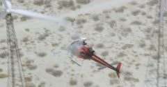WS AERIAL TS ZO View of helicopter moving above landscape with modern windmill - stock footage