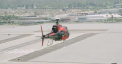 WS AERIAL TS Helicopter flying around runway and car park area - stock footage
