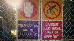 Warning Danger Signs On Fence Stock Footage