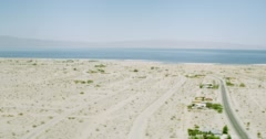 WS AERIAL View of desert area with sea Stock Footage