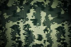 Fabrics with camouflage pattern Stock Photos